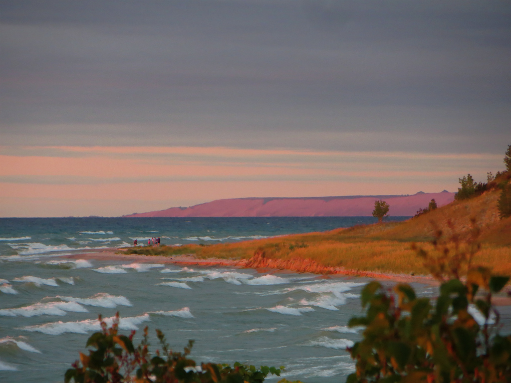 In the distance, and colored purple by the setting sun. Zoomed from the Point Betsie Lighthouse on a beautiful windy evening. -Photo by Rachel Cramer on Flickr